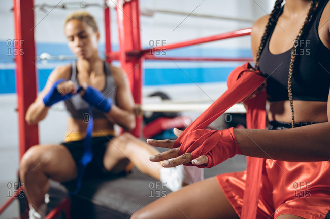 Female boxers wearing hand wrap at boxing club