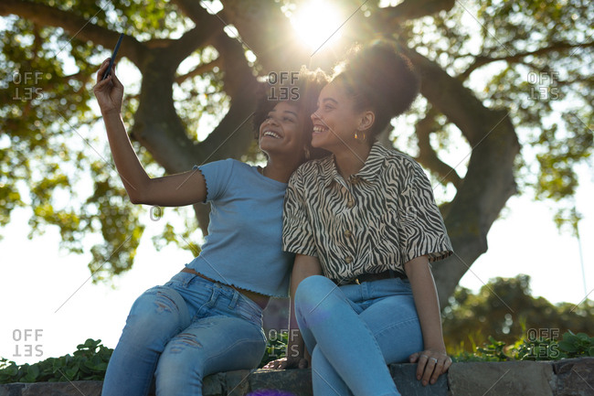 Two young women taking selfie outdoors