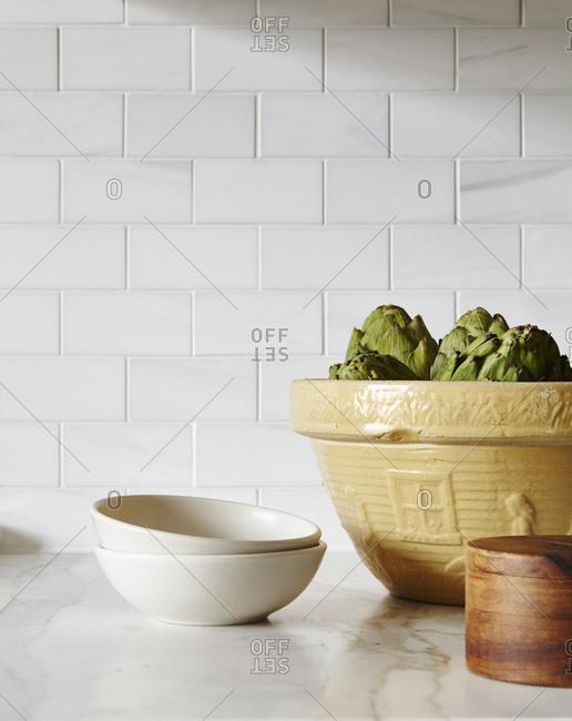 Bowls on a white stone kitchen counter