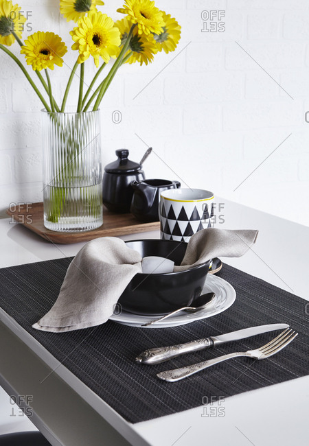 Table setting for one with black and white dishes