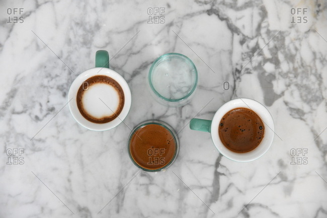 Variety of coffee beverages on marble surface