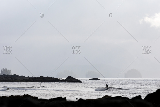 Surfer riding a small wave