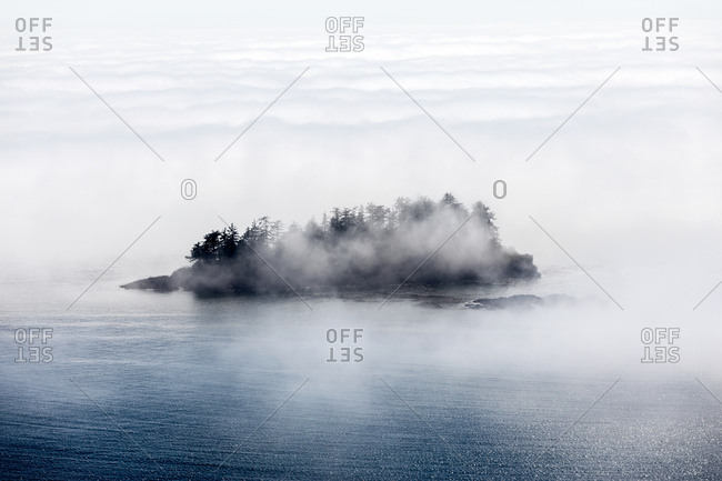 Dense fog surrounding island