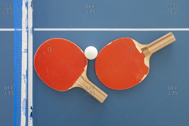 Ping pong paddles and ball on table