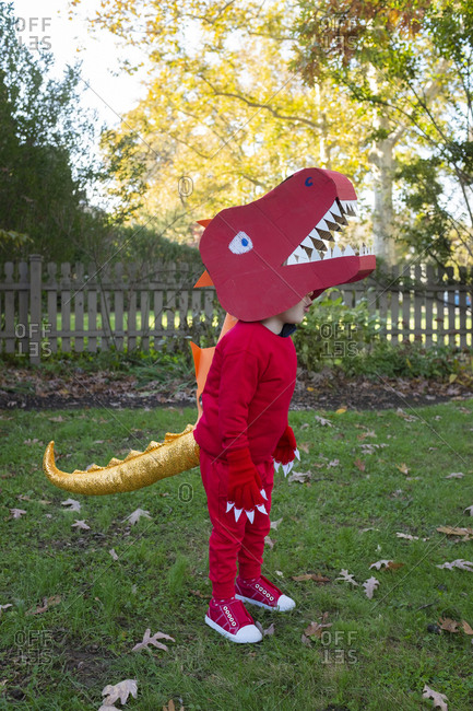Boy dressed up as red dinosaur