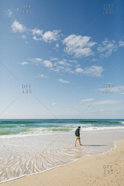 Boy walking on beach