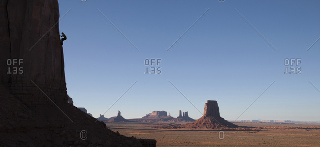 Silhouette of rock climber in Monument Valley Navajo Tribal Park, USA