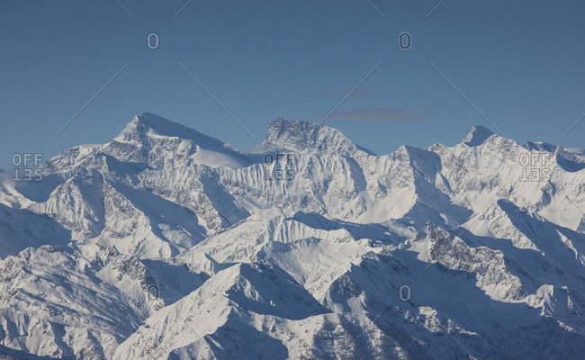 Snow covered mountain range in Piedmont, Italy