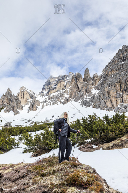Woman hiking on Giau Pass in Dolomites, Italy