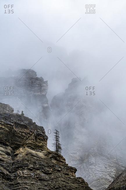 Cliffs in fog in Dolomites, Italy