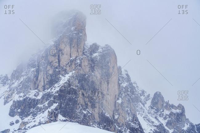 Ra Gusela mountain peak in fog in Dolomites, Italy