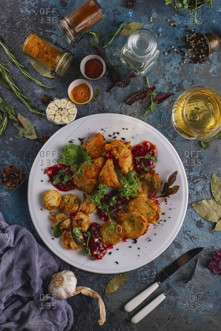 Tempura vegetables with glass of white wine