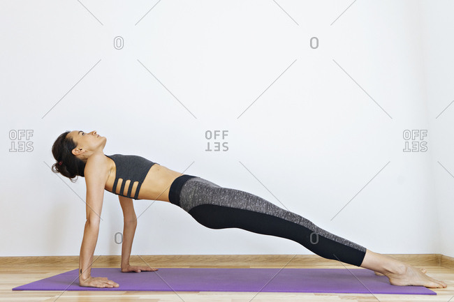 Woman in plank pose practicing yoga