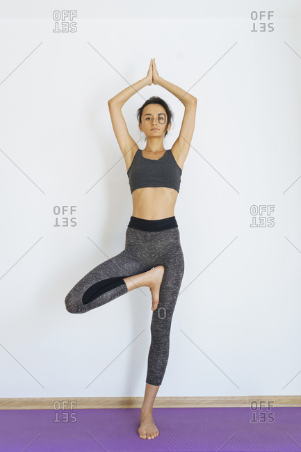 Woman standing on one leg practicing yoga