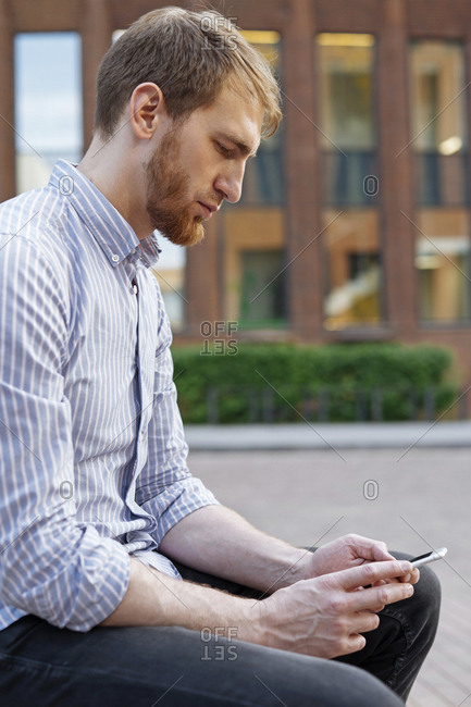 Bearded man using smart phone