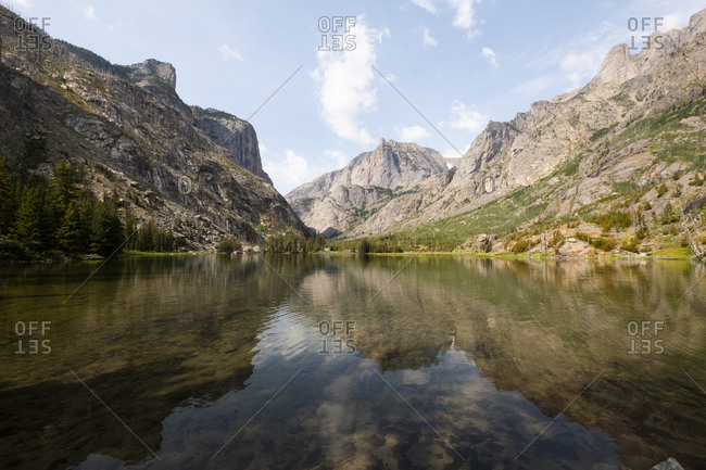 Mountain reflected in river in Montana, USA