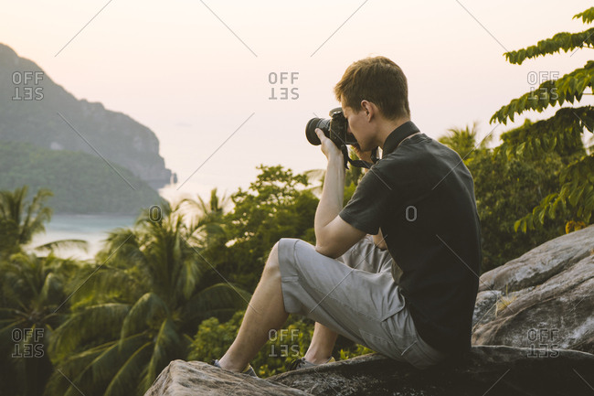 Man photographing palm trees on Phi Phi Islands, Thailand