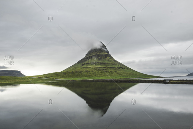 Kirkjufell under overcast sky in Iceland