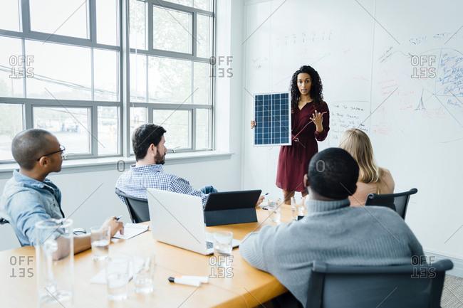 Women using diagram during office presentation