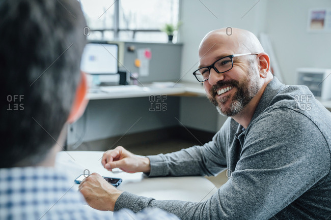 Smiling man during meeting in office