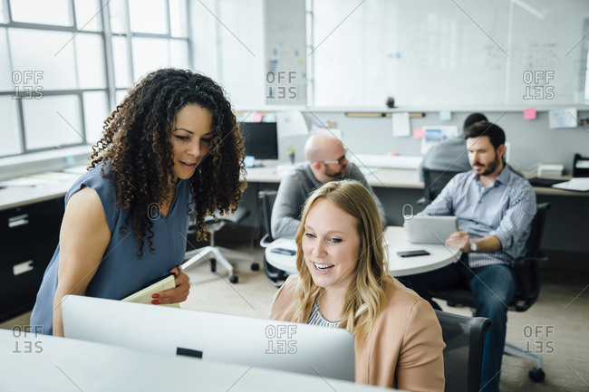 Women using computer in office