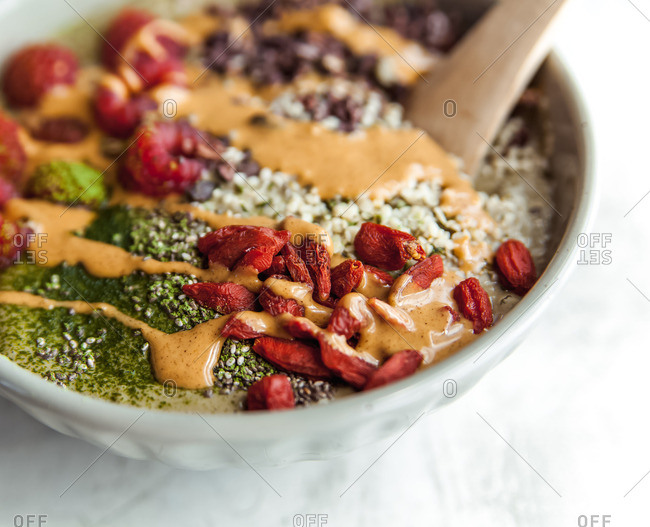 superfood smoothie bowl with matcha, goji berries, cacao nibs and hemp seeds