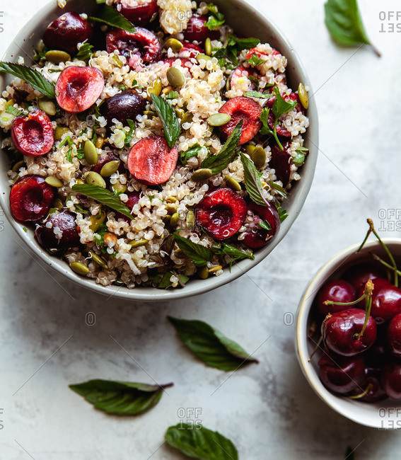quinoa grain bowl salad with cherries, pepitas and mint