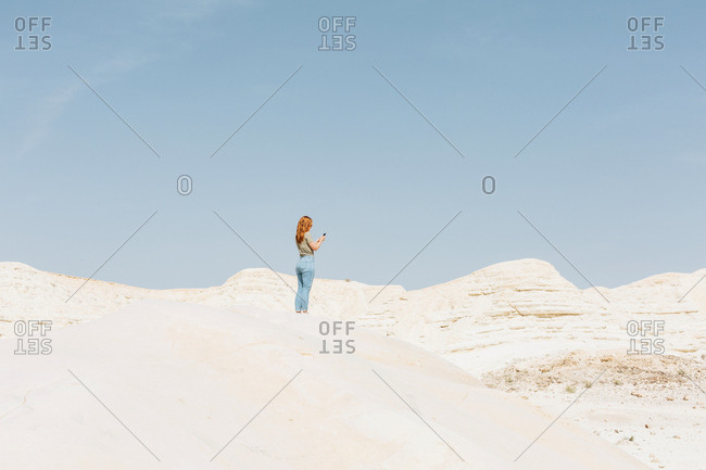 Woman hiking in Nitzana Park Rock formation, in Negev Desert Israel