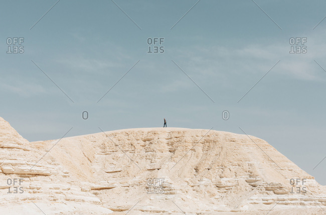 Person hiking in Nitzana Park Rock formation, in Negev Desert Israel