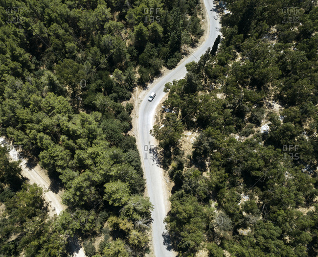 Aerial view of winding road in a forest in north of Israel