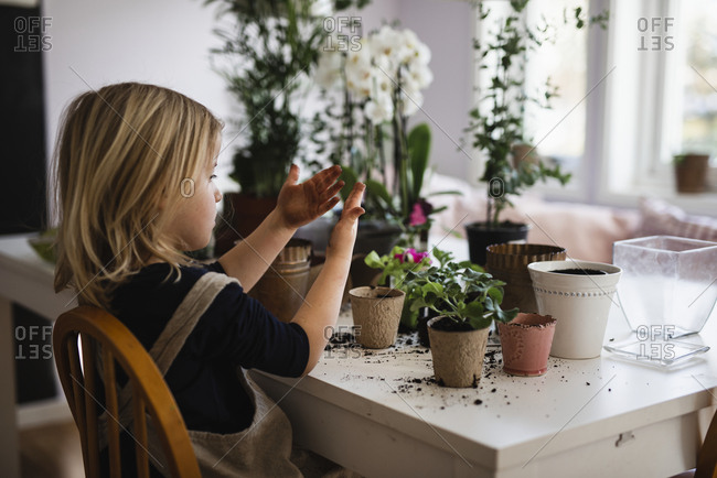 Girl potting flower