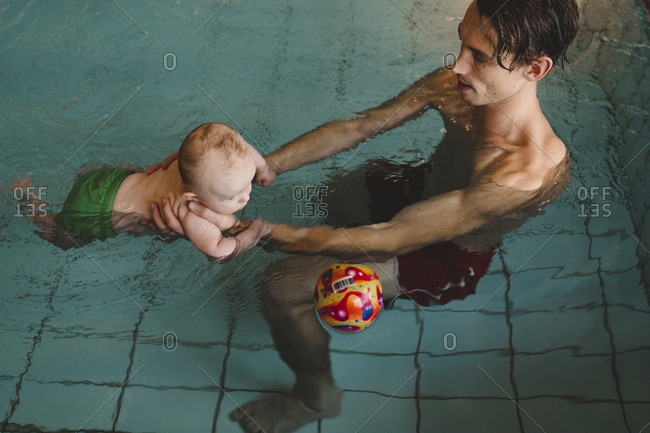 Father with baby in swimming-pool