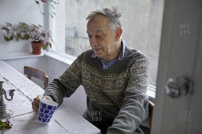 Senior man having drink