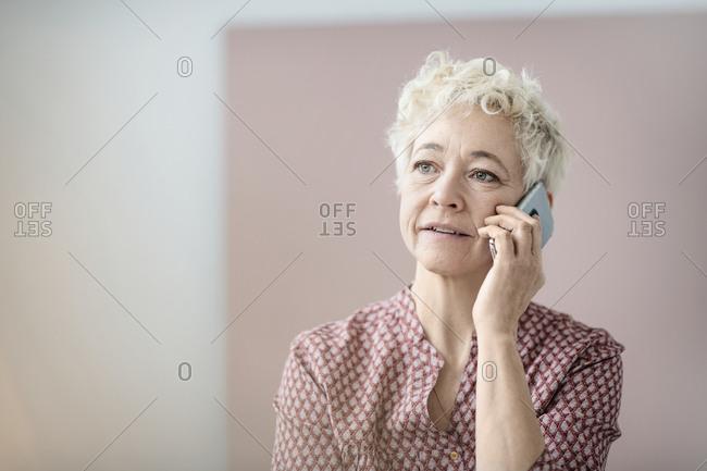 Mature woman talking via cell phone