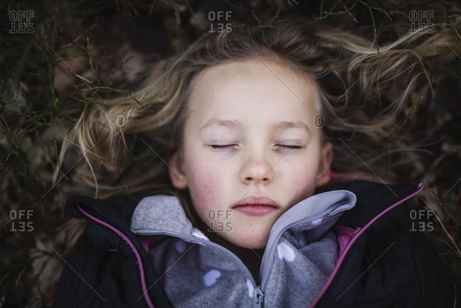 Girl with eyes shut