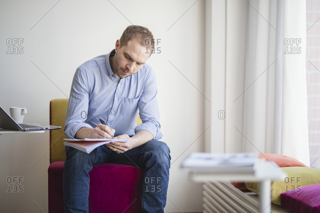 Man writing on notepad