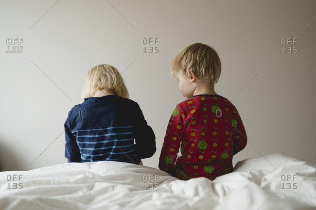 Kids sitting on bed