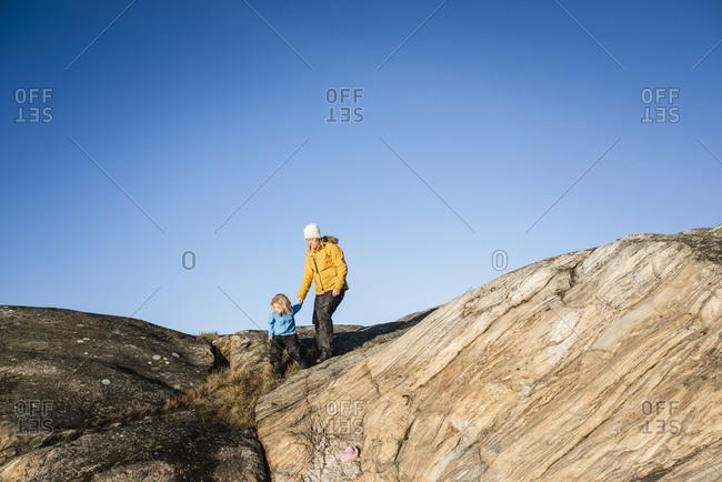 Woman and girl on rocks
