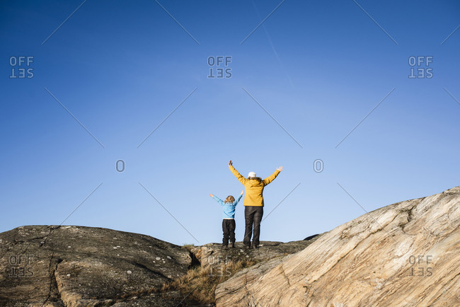 Woman and girl standing on rocks