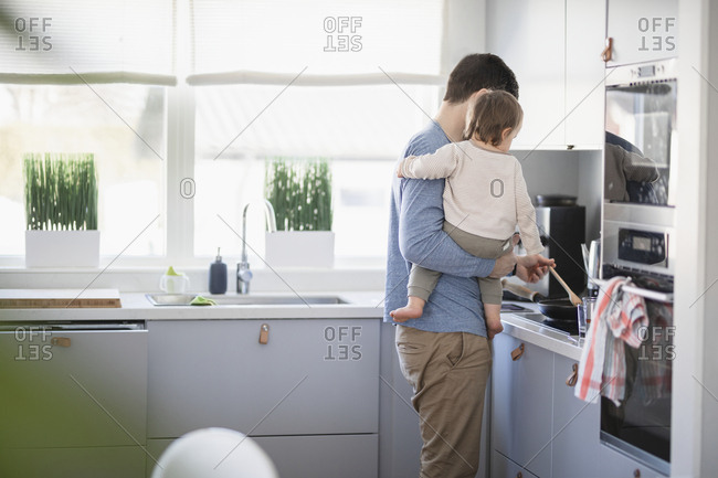 Father with baby in kitchen