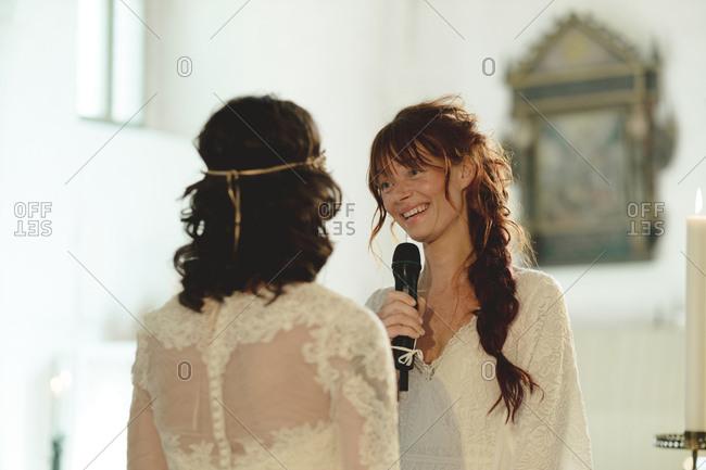 Brides at wedding ceremony