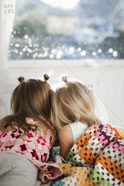 Girls share a blanket together