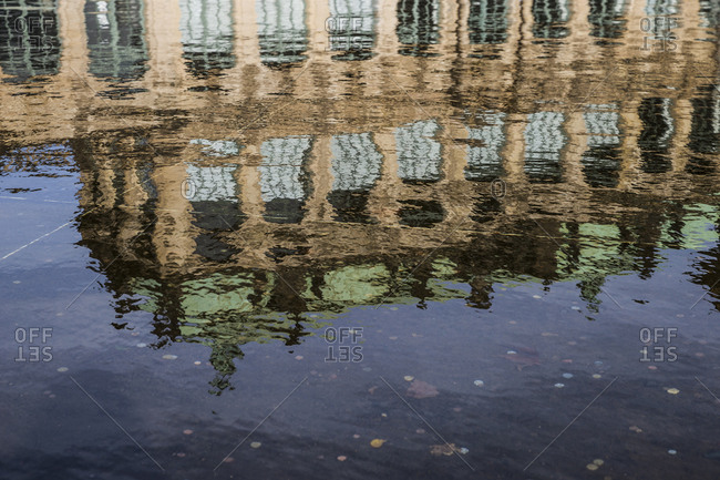 Part of the Zwinger reflected in a pool of water in Dresden, Germany