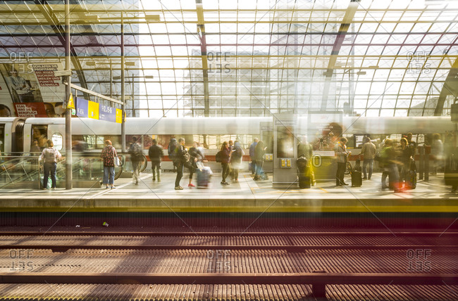August 31, 2018: Passengers waiting for trains on a platform at the main train station (Hauptbahnhof), Berlin, Germany.