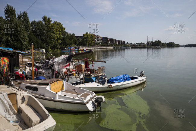 August 17, 2018: Boats moored on the shore of the Rummelburger See in Berlin, Germany.