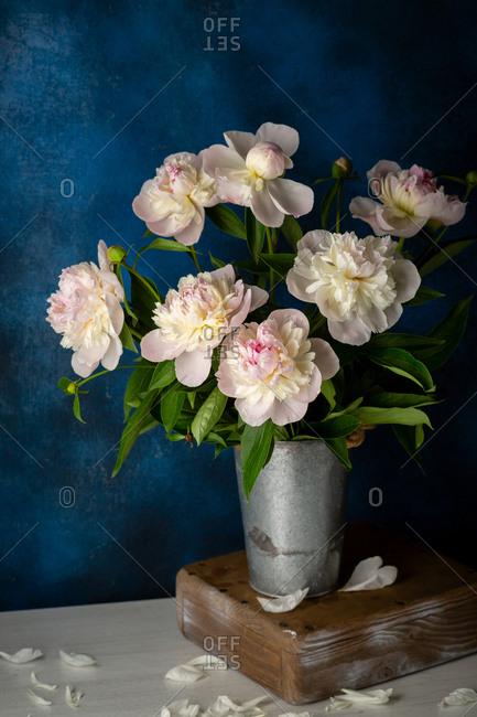 Pink peonies in a vintage metal vase