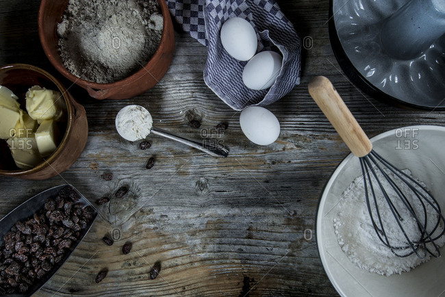 Overhead view of ingredients of a sorgho cake on a rustic wooden background