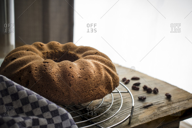 Close up of hot baked sorgho cake on a wire cooling rack