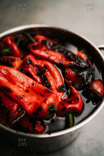 Roasted red peppers cooking in a pot