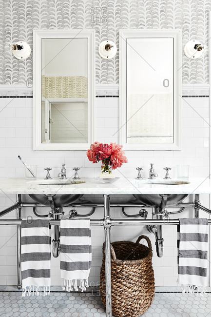 Los Angeles, California - May 31, 2019: Interior of a bathroom with marble vanity and white subway tiles